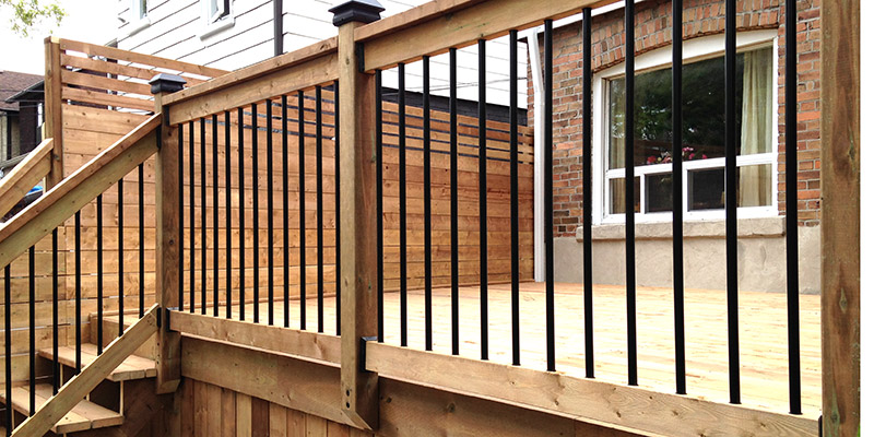 Wooden railing with metal pickets