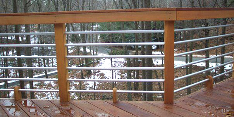 Wooden railing with metal pipes